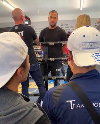 Inoue's trainer-father pushed by Team Rodriguez member at Media Workout in Glasgow
